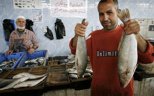 Palestinians in a market in Rafah, Gaza Strip, sell fish smuggled through tunnels from the border between Egypt and Rafah on April 16, 2012 (photo credit: Abed Rahim Khatib/Flash90)