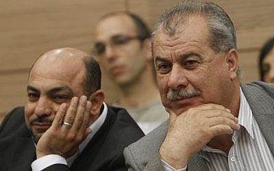 Hadash party leader Mohammad Barakeh (right) and MK Masoud Ganaim in April, 2012. (photo credit: Miriam Alster/Flash90)