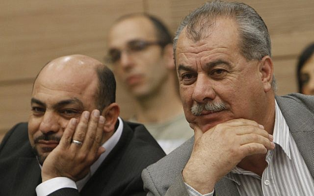 Former MK Mohammad Barakeh (right) and lawmaker Masoud Ganaim, pictured in April, 2012. (Miriam Alster/Flash90)