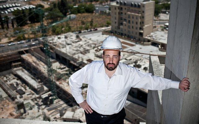 Housing and Construction Minister Ariel Atias, of the ultra-orthodox Shas party, looks over a construction site on June 22, 2012. (photo credit: Noam Moskowitz/Flash90)
