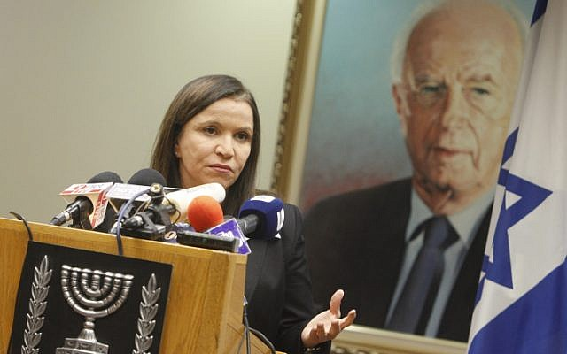 Labor Party chairwoman Shelly Yachimovich seen here under a portrait of former prime minister and Oslo Accords signatory Yitzhak Rabin (photo credit: Miriam Alster/Flash90)