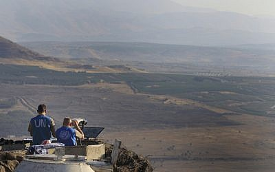 UN peacekeepers monitor the Syrian side of the Golan Heights in July 2012 (photo credit: Tsafrir Abayov/Flash90)
