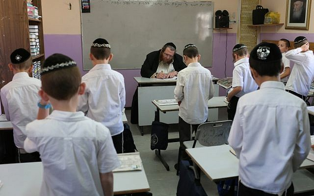 Ultra-Orthodox students seen learning in the classroom of a Haredi 'Talmud Torah' in the settlement of Beitar Illit. (photo credit: Nati Shohat/Flash90)