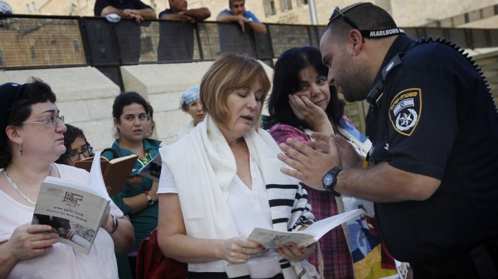 Women of the Wall activists are confronted by police for wearing prayer shawls at the Western Wall, October (photo credit: Miriam Alster/Flash90)