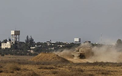 Illustrative photo of an Israeli tank along the Gaza border (photo credit: Tsafrir Abayov/Flash 90)