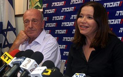 Uri Sagi with Labor leader Shelly Yachimovich during a press conference in 2012. (photo credit: Roni Schutzer/Flash90)