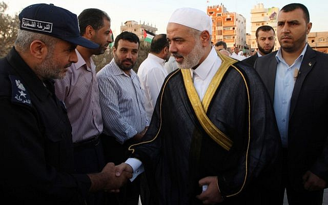 Hamas leader Ismail Haniyeh speaks with Palestinian security officers before giving a speech during a mass prayer on the first day of the Muslim holiday of Eid al-Adha, October 26, 2012 (photo credit: Abed Rahim Khatib/Flash90)