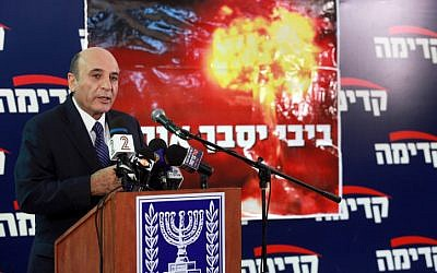 Kadima head Shaul Mofaz presents the party's election campaign slogan, 'Bibi will get us in trouble,' in November (photo credit: Flash90)