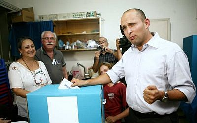 Naftali Bennett casts his vote in his successful campaign to lead the Jewish Home party, in November (photo credit: Yehoshua Yosef/Flash90)