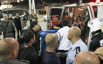 Border policemen were injured during riots in Shuafat, Tuesday (photo credit: Oren Nahshon/Flash90)
