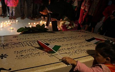Palestinians gather to light candles at the mausoleum of late PLO  leader Yasser Arafat in the West Bank city of Ramallah, on November 10, ahead of a ceremony marking the eighth anniversary of his death (photo credit: Issam Rimawi/Flash90)