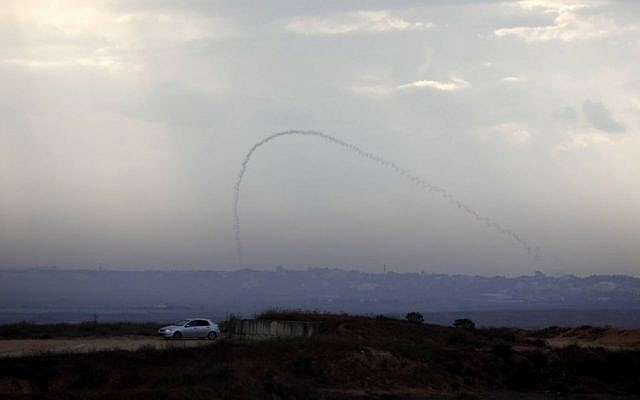A trail of smoke is seen as a rocket is launched from the Gaza Strip toward the southern Israeli city of Sderot, last year (photo credit: Edi Israel/Flash90/File)