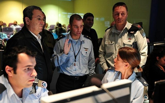 Defense Minister Ehud Barak (left in black) supervises the launching of a Patriot missile during air defense exercises on November 12, 2012 (photo credit: Defense Ministry/Flash90)