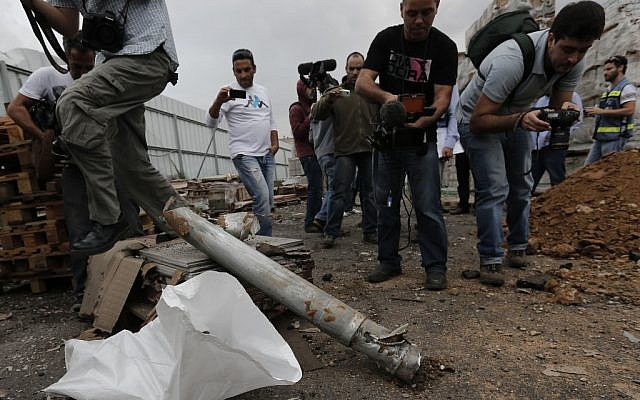 The remains of a rocket that hit a Netivot factory on Monday. (photo credit:  Tsafrir Abayov/Flash90)