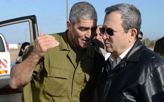GOC Southern Command Maj. Gen. Tal Russo (left) and Defense Minister Ehud Barak (right) talk on a base near the border of the Gaza Strip on Wednesday. (photo credit: Ben Avraham/Defense Ministry/Flash90)