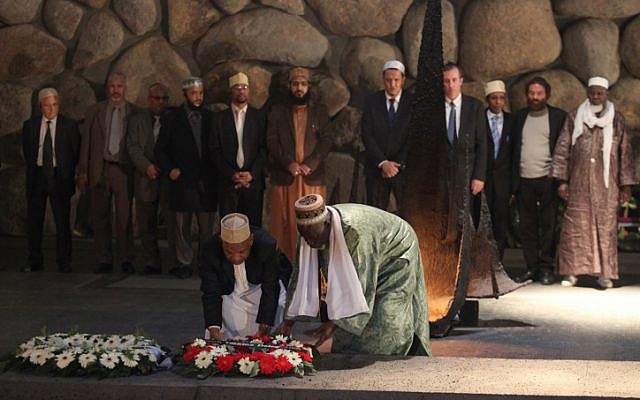 French Imams lay a wreath at the Holocaust memorial site in Yad Vashem, Tuesday (photo credit:  Yoav Ari Dudkevitch/Flash90)