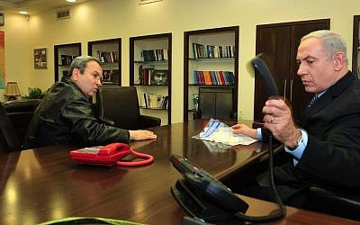 Benjamin Netanyahu, right, speaking with Ehud Barak at the Defense Ministry in 2012 (Ariel Hermoni/Defense Ministry/Flash90)