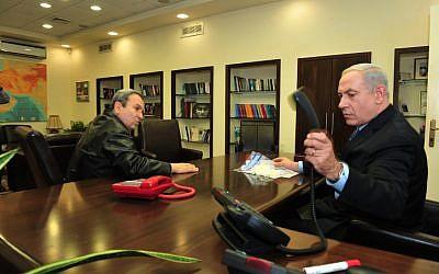 Prime Minister Benjamin Netanyahu speaks with Defense Minister Ehud Barak at the Defense Ministry in Tel Aviv on November 14, 2012. (photo credit: Ariel Hermoni/Defense Ministry/Flash90)