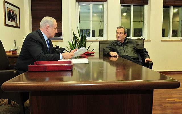 Prime Minister Benjamin Netanyahu speaks with Defense Minister Ehud Barak at the Defense Ministry in Tel Aviv on November 14, 2012. (photo credit: Ariel Hermoni/Ministry of Defense/Flash90)