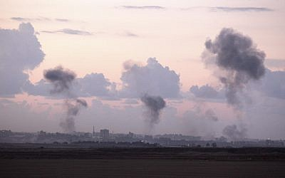 Smoke rises following an Israeli air strike on targets in Gaza City, on November 14, 2012. (photo credit: Edi Israel/Flash90)