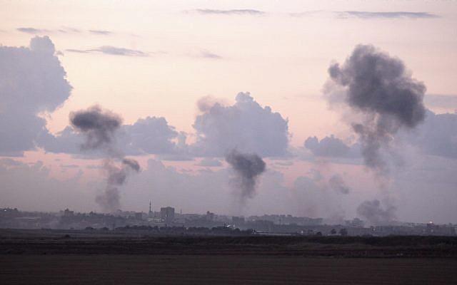Smoke rises following an Israeli air strike on targets in Gaza City, on November 14, 2012. (photo credit: Edi Israel/Flash90)