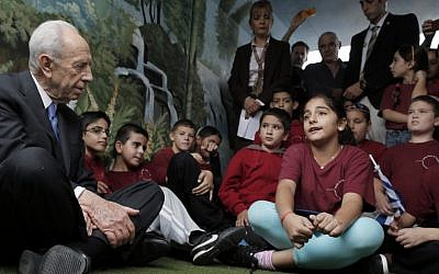 President Shimon Peres visits Israeli children in a shelter in the southern city of Sderot on Wednesday (photo credit: Tsafrir Abayov/Flash90)