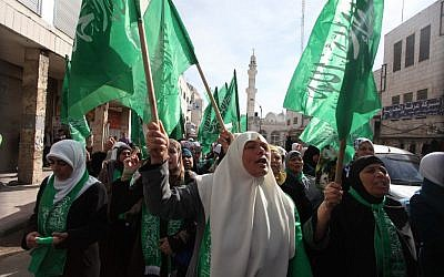 Palestinians wave Hamas flags during a demonstration in solidarity with Gaza and against Israel's military operation in the coastal enclave, in the WestBank city of Ramallah November 16, 2012 (photo credit: Issam Rimawi/Flash90)