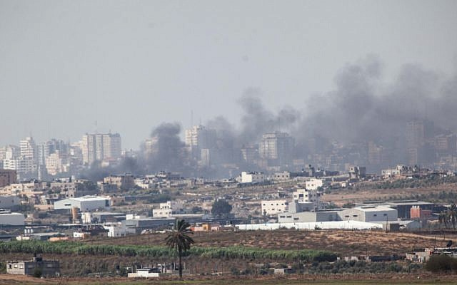 Smoke rises from a building in the northern Gaza Strip after an Israeli airstrike on November 16, 2012 during Operation Pillar of Defense. (photo credit: Uri Lenz/Flash90)
