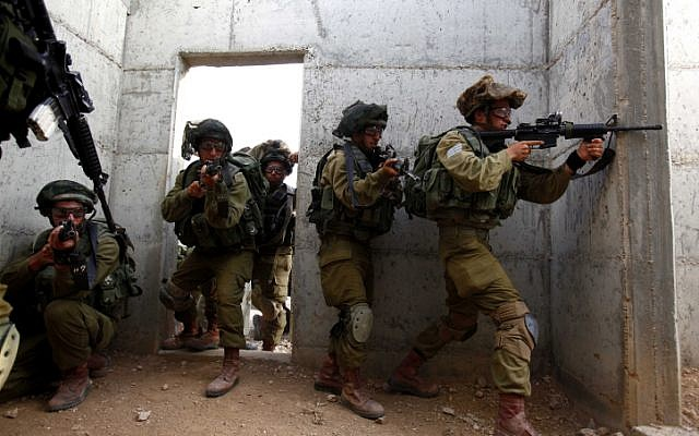 Soldiers take part in exercises simulating fighting in Gaza, at a military base in the Negev on November 17 (photo credit: Edi Israel/Flash90)