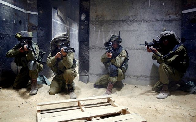 Israeli soldiers attend a training session simulating fighting in Gaza, at an IDF military training base, November 17, 2012. (photo credit: Edi Israel/Flash90)