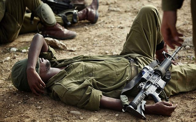 A soldier rests during training exercises on Saturday. (photo credit: Edi Israel/Flash90)