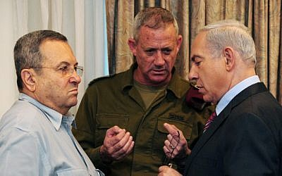 Prime Minister Benjamin Netanyahu (right) speaks with IDF Chief of Staff Lt.-Gen. Benny Gantz (center) and Defense Minister Ehud Barak (left) ahead of the weekly cabinet meeting in Jerusalem on Sunday, November 18, 2012. (photo credit: Kobi Gideon/GPO/Flash90)