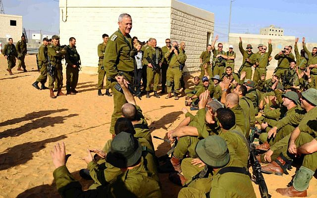 IDF Chief of Staff Benny Gantz speaks with reserve soldiers at the Tze'elim training base on November 18, 2012. (photo credit: IDF Spokesperson's Office/Flash90)