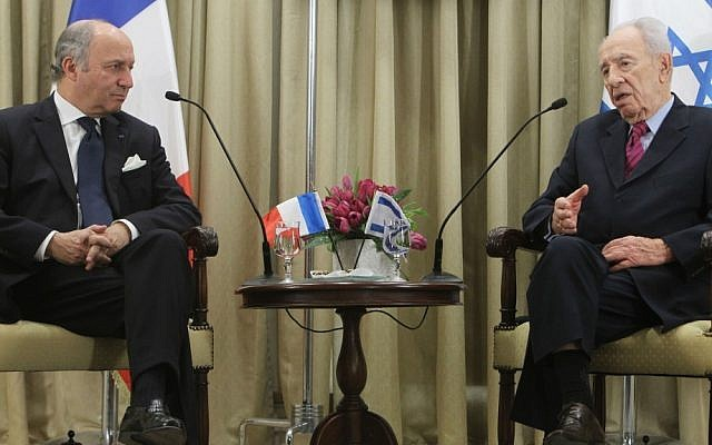 President Shimon Peres meets with French Foreign Minister Laurent Fabius in Jerusalem on Sunday. (photo credit: Miriam Alster/Flash90)