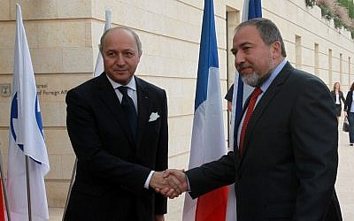 French Foreign Minister Laurent Fabius, left, and his Israeli counterpart Avigdor Liberman deliver statements to the media in Jerusalem on Sunday (photo credit: Yossi Zamir/Flash90)