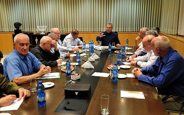 Ehud Barak, in black, meeting with defense brass over Operation Pillar of Defense on Monday. (photo credit: Ariel Hermoni/Defense Ministry/Flash90)