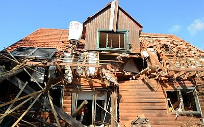 A house in the village of Timorim, in central Israel, was hit by a rocket fired by Gaza terrorists, November 19, 2012. (photo credit: Yossi Zeliger/Flash90)