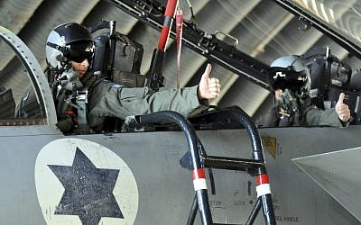 Israeli pilots in the cockpit of an F-15 fighter jet in an Israeli Air Force base. (Yossi Zeliger/Flash90)