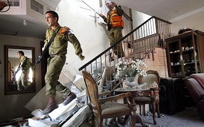 Soldiers inspecting a home hit by a missile in Beersheba Tuesday. (photo credit: Miriam Alster/Flash90)