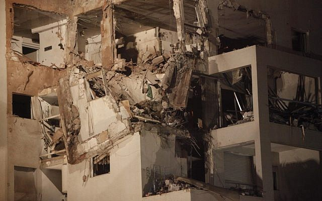An apartment building in Rishon Lezion that was hit by a Fajr rocket from Gaza on Tuesday evening (photo credit: Miriam Alster/Flash90)