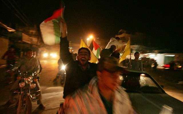Palestinians celebrate in the streets of Gaza as Israel and the Islamist Hamas movement agreed on Wednesday to an Egyptian-sponsored ceasefire to halt an eight-day conflict November 21, 2012 (photo credit: Abed Rahim Khatib/Flash90)