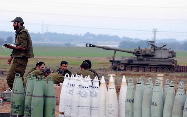 A mobile artillery unit positioned outside the northern Gaza Strip on Wednesday. (photo credit: Yozzi Zeliger/Flash90)