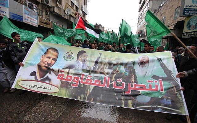 Hamas supporters rally in the West Bank city of Ramallah, on Friday, November 23 (photo credit: Issam Rimawi/Flash90)