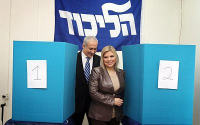 Prime Minister Benjamin Netanyahu casts his vote in the Likud primary elections together with his wife Sara, on November 24  (photo credit: Gil Yohanan/Flash90)