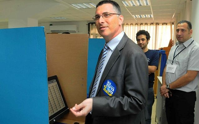 Minister of Education Gideon Sa'ar tries to cast his vote as Likud opened the polls for its primary elections on Sunday (photo credit: Yossi Zeliger/Flash90)