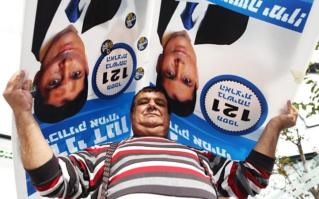 A Likud supporter outside the Kfar Saba Likud polling place on Nov 26, 2012. (photo credit: Yehoshua Yosef/Flash90)