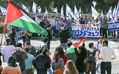 Demonstrators and counter-demonstrators of Israel's Operation Pillar of Defense at the Hebrew University of Jerusalem on Thursday. (photo credit: Oren Nahshon/Flash 90).