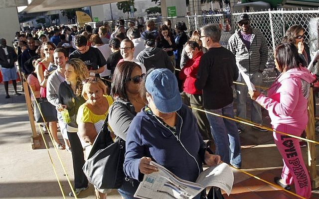 Early voters stand in line in Miami, Florida, on Saturday (photo credit: AP/Alan Diaz)