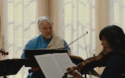 "Oscar winner Philip Seymour Hoffman, left, in Yaron Zilberman's ""A Late Quartet."" (Courtesy of RKO Pictures)"