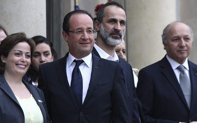 French President Francois Hollande, second from left, head of the new Syrian National Coalition for Opposition and Revolutionary Forces Mouaz al-Khatib, second from right, Syrian opposition member Suheir Atassi, left, and French Foreign Minister Laurent Fabius, right, pose for photos prior to a meeting at the Elysee Palace, Paris, Saturday, November 17, 2012 (photo credit: AP/Thibault Camus)